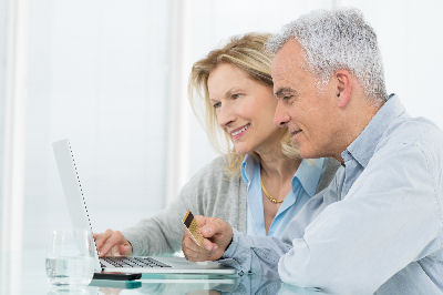 http://www.dreamstime.com/royalty-free-stock-photography-senior-couple-shopping-online-portrait-credit-card-image30882257